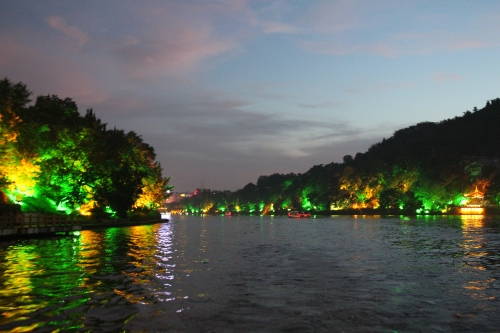 Beautifully lit trees along the embankment