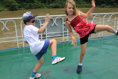 Oliver and Isabelle practising Kung Fu on the top of the boat.